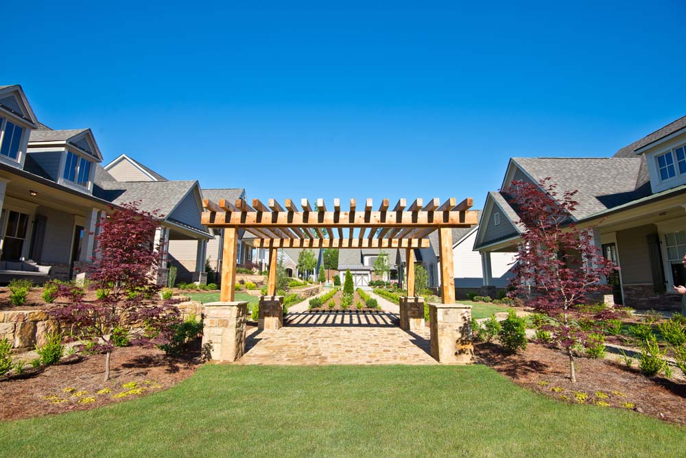Relaxing green spaces are expertly landscaped at Oakhurst in Woodstock GA