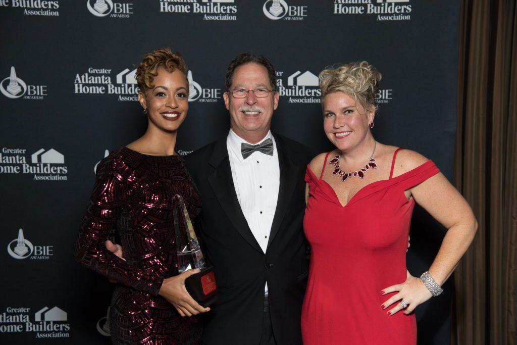 Olivia Westbrooks, SteveBrock, and Ansley Brooks pose with OBIE award