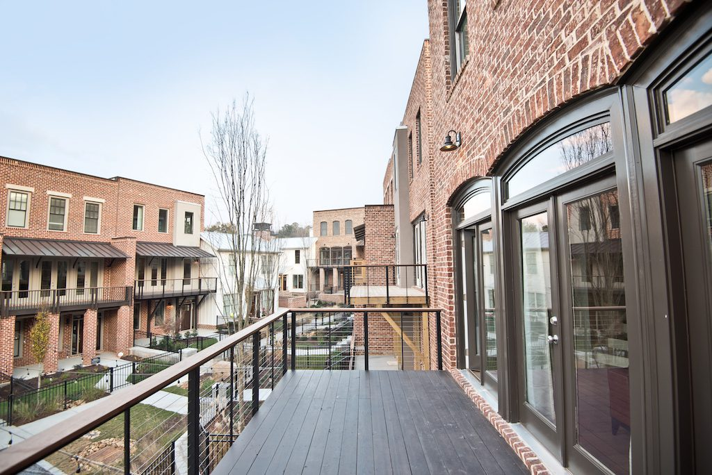 Balcony of newly decorated model home overlooking the community mews of Westside Station