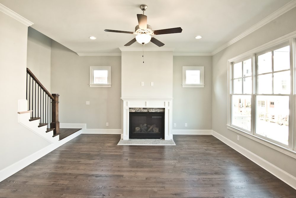 Beautiful fireplace with stone accents in the Fallbrook IV