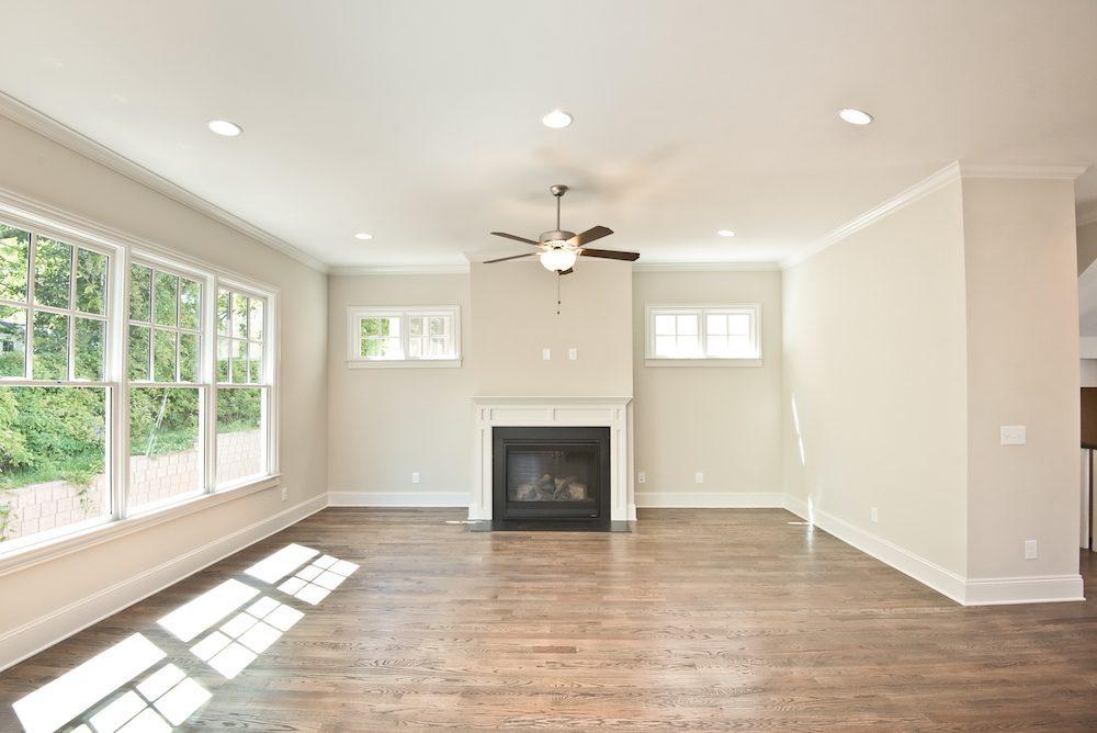 Beautiful fireside living room in the Golden Oaks IV floor plan