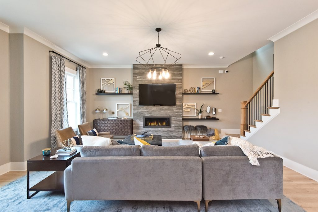 Cozy fireside family room at Westside Station's newly decorated model