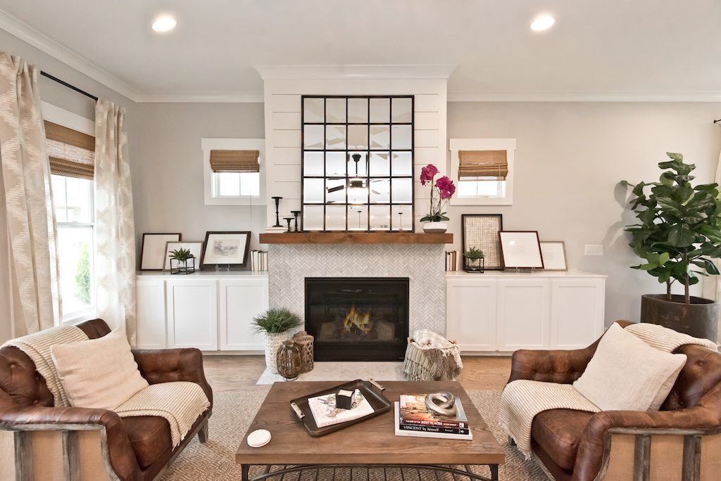 Warm up to your new home in the new year by your stylish, eye-catching fireplace.