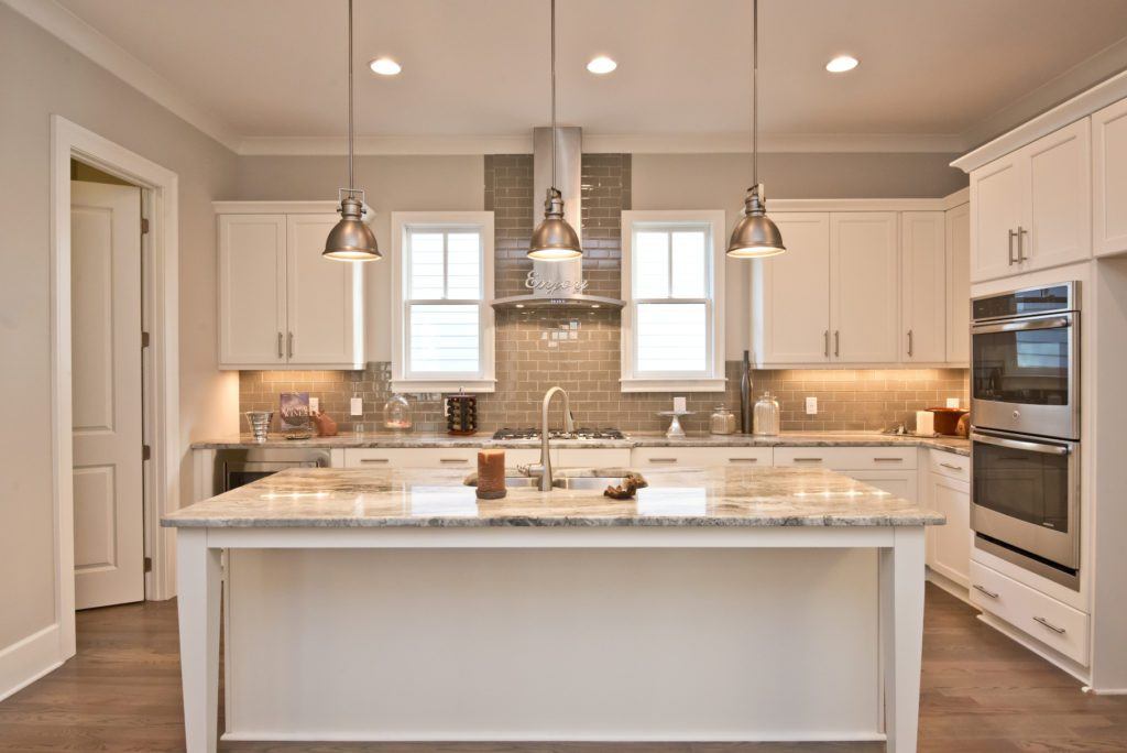 A kitchen with Energy Star appliances in a new eco-friendly home