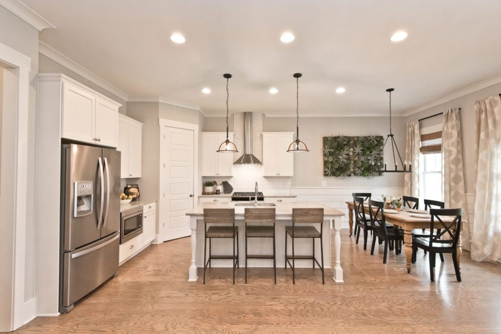 Open floor plan kitchen/ dining area in west highlands model home